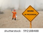 small figure of a man with work ... | Shutterstock . vector #592188488