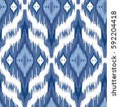 ikat ogee background   ethnic... | Shutterstock .eps vector #592204418