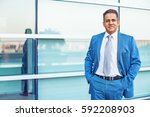 mixed race guy wearing a blue... | Shutterstock . vector #592208903