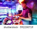 blurred tattoo dj playing music ... | Shutterstock . vector #592230719