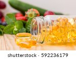 fish oil  omega 3 with vitamin... | Shutterstock . vector #592236179