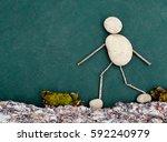sticks and stones guy walking... | Shutterstock . vector #592240979