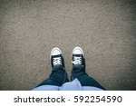 pair of legs and shoes on...   Shutterstock . vector #592254590