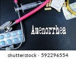 Small photo of Amenorrhea word, medical term word with medical concepts in blackboard and medical equipment background