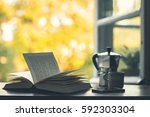 morning coffee and a book on... | Shutterstock . vector #592303304