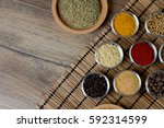 various fresh spices in bowls ... | Shutterstock . vector #592314599