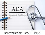 stethoscope on notebook and... | Shutterstock . vector #592324484