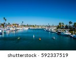 paddle boarders on a long beach ... | Shutterstock . vector #592337519