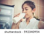 pregnant woman drinking milk | Shutterstock . vector #592340954
