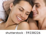 young smiling couple in a bed... | Shutterstock . vector #59238226