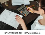 young female accountant... | Shutterstock . vector #592388618