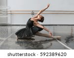 beautiful ballerina sit on the... | Shutterstock . vector #592389620