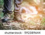shoes man walking on a forest... | Shutterstock . vector #592389644