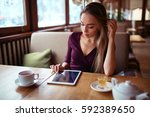 woman with tablet pc using... | Shutterstock . vector #592389650