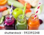 various freshly squeezed... | Shutterstock . vector #592392248