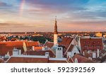 red roofs of old town against... | Shutterstock . vector #592392569