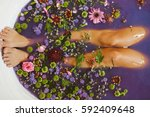 woman legs in bath tube with... | Shutterstock . vector #592409648