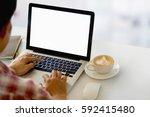 man working with blank screen... | Shutterstock . vector #592415480