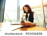 hipster girl use laptop huge... | Shutterstock . vector #592456838