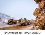 truck loading. gold mining | Shutterstock . vector #592460030