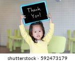cute little child girl holding... | Shutterstock . vector #592473179