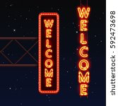 street sign that says welcome.... | Shutterstock .eps vector #592473698