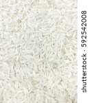 Small photo of Food, Background of Uncooked White Long Rice, Basmati Rice or Jasmine Rice.