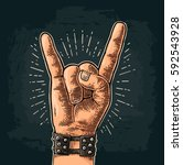rock and roll sign. hand with... | Shutterstock .eps vector #592543928