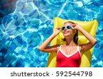enjoying suntan and vacation.... | Shutterstock . vector #592544798