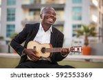 black smiling man wearing... | Shutterstock . vector #592553369