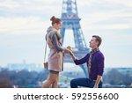 romantic engagement in paris ... | Shutterstock . vector #592556600
