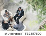 young asian business team... | Shutterstock . vector #592557800