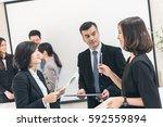 asian business people meeting... | Shutterstock . vector #592559894
