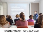 female speaker giving... | Shutterstock . vector #592565960
