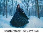 young girl walking in winter... | Shutterstock . vector #592595768