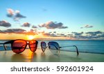 sunglasses at sunset on famous... | Shutterstock . vector #592601924