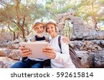 travel and technology. senior... | Shutterstock . vector #592615814