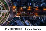 road roundabout with car lots... | Shutterstock . vector #592641926