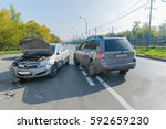 two cars crashed on the road in ... | Shutterstock . vector #592659230