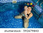 swimming instructor teaching... | Shutterstock . vector #592679843