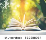 open book on a white table in... | Shutterstock . vector #592688084
