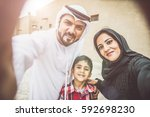 arabian family portrait in the... | Shutterstock . vector #592698230