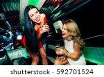 beautiful girls making party in ... | Shutterstock . vector #592701524