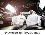 two arabian businessmen talking ... | Shutterstock . vector #592704833