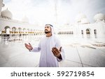 arabic man at the mosque... | Shutterstock . vector #592719854