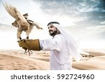 arabic man with traditional... | Shutterstock . vector #592724960