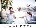 arabic business men spending... | Shutterstock . vector #592728566