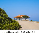 Small photo of Traditional small white church with sea view in Cassandra peninsula,Greece.
