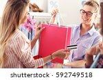 female customer receiving... | Shutterstock . vector #592749518