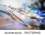 satin ribbon blue on the wind.... | Shutterstock . vector #592750940